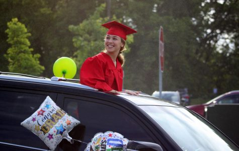 Sivan Rodin looks back at classmates in the parking lot start of the Class of 2020 parade on May 27, 2020. Graduation has been pushed back until July 28 due to coronavirus, so the parade helped the grads feel celebrated.
