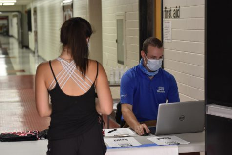 Ava Wittner, Junior checking in with trainer at the first day of practice, Sept.24.
