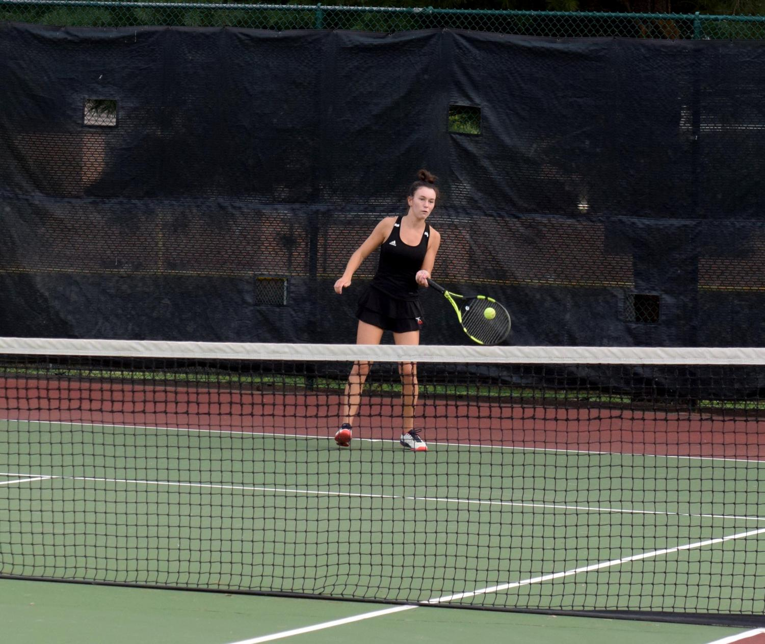 Junior Maggie Huff returning a ball to the other team at the match against Lafayette on Sept. 15. The team won this match.