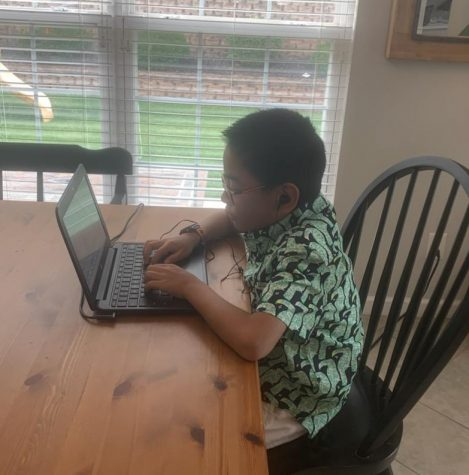 "Dexter Wong goes to his fifth grade class at Shenandoah Valley Elementary online. ""I would really like going back to school,"" he said. ""It's like we all probably took it for granted until it was gone."" Photo by Ann Wong."
