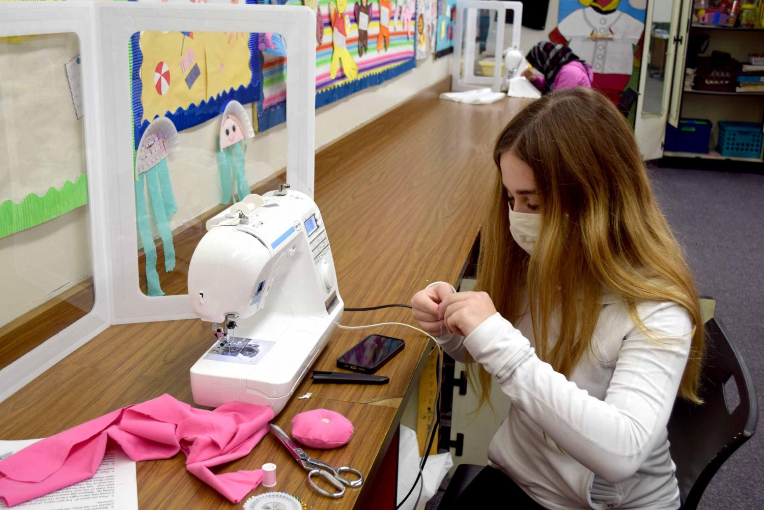 Zoe Snitzer (9) sews a pin cushion during Fashion Apparel and Housing Design class on her last day of in-person learning on Nov. 20.  Snitzer attended just four days of in-person school before the district decided that middle and high school would return to virtual learning for the remainder of the second quarter.