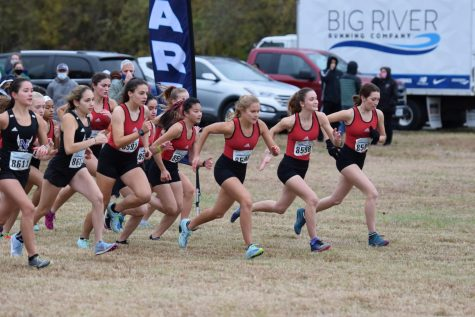 Girls varsity at the start line at Buder Park on Oct. 23, 2020. Their bus arrived late, but they persevered through yet another challenge, many girls finishing with a personal record.