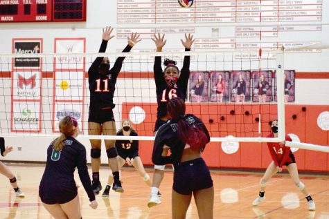 Junior Kaye Tate and senior Deja Campbell go up for a block in the Senior Night game against Pattonville on Oct. 21.