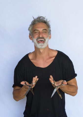 Adam Saaks poses for his promo shot with two pairs of scissors.
