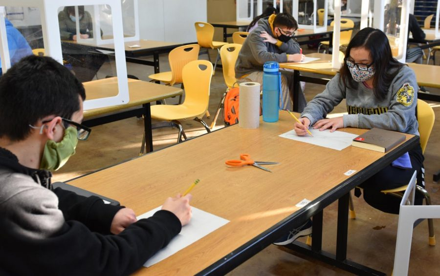 Students are working on an assignment drawing scissors.