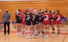 Girls volleyball stand for the pledge before a game on October 21, 2020.