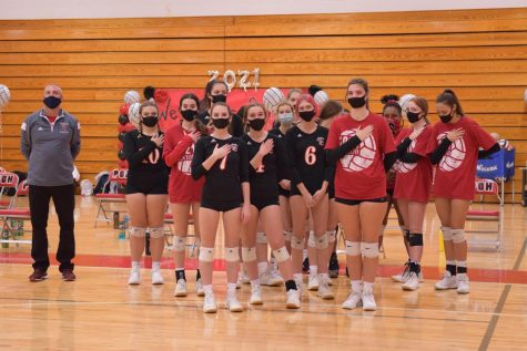 "Girls volleyball stand for the pledge before a game on October 21, 2020. ""When we do add the pledge to sporting events, people don't really see the significance of it,"" Sivabalakannan said. ""We"