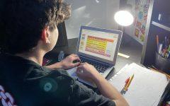 Freshman Jacob Abowitz does homework on his school issued Chromebook