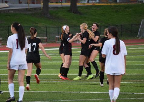 Soccer players celebrate Emily Lander