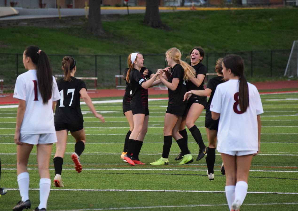 Soccer players celebrate Emily Landers goal in the game against MICDS on April 12.  The Colts beat the Rams 2-1