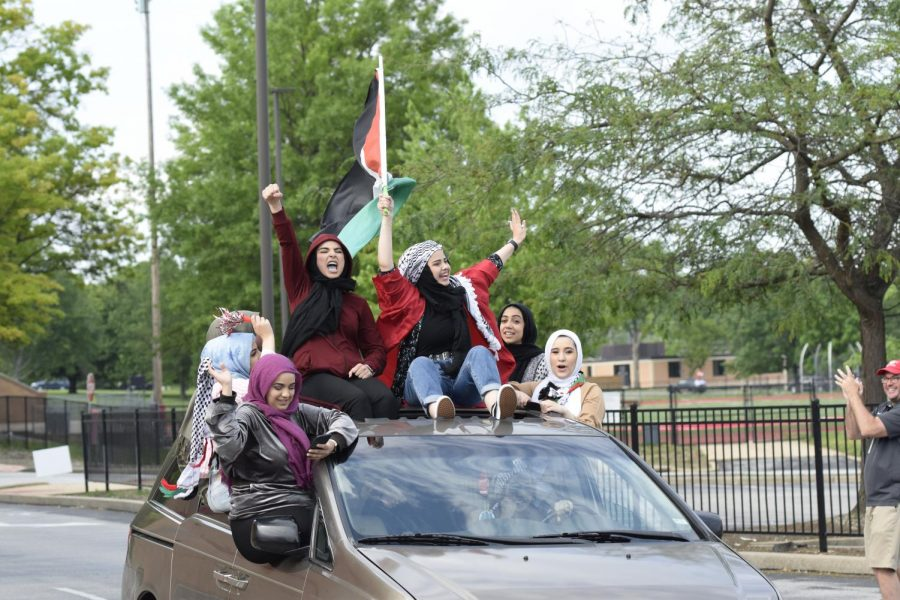 Shahd Abdelbaset celebrates with the class of 2021. She brought a Palestinian flag to her graduation parade on May 23.