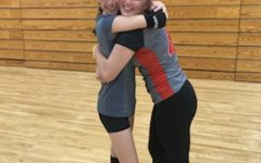 Lana (right) and Keri (left) Piepho hug. The sisters play volleyball together.